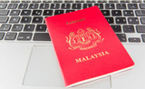 A Malaysian Passport on a laptop.