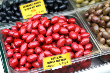 Red XXXL olives with stone at the market