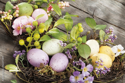 Easter eggs hidden in natural straw nest