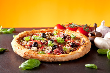 Fresh italian pizza served on black stone