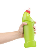 Hand holding green bottle.