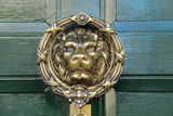 A Large Brass Lion Face Design Door Knocker.