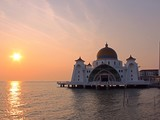 view of malacca straits mosque at sunset
