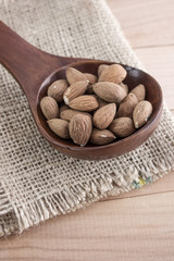 Almonds kernel in awooden spoon