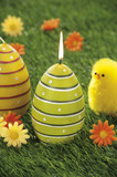 Easter eggs candles hidden in natural straw nest