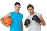 Fit men with boxing gloves and basketball