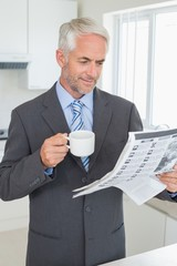 Smiling businessman having coffee in the morning before work