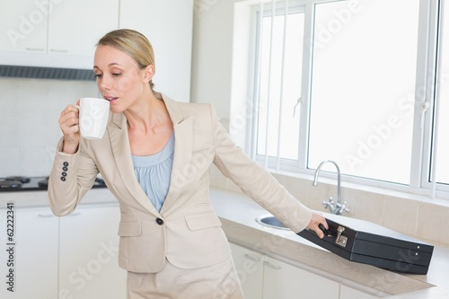 Businesswoman rushing out the door to work in the morning