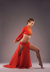 Studio shot of a beautiful sporty woman in red clothing