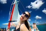 Happy young woman enjoying on luxury boat