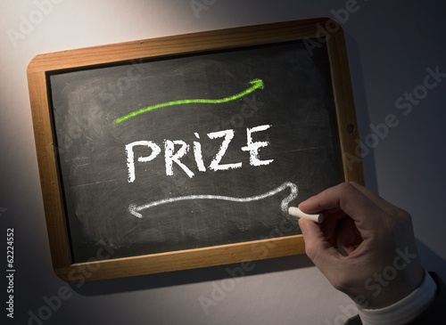 Hand writing Prize on chalkboard
