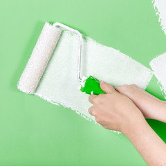 Hand with paint roller
