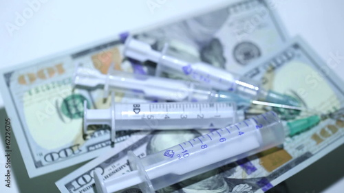 Medical syringes and money close up. Top view