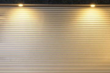 background of Illuminated grunge metallic roller shutter door