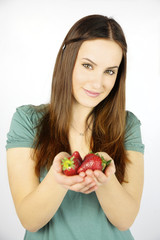Happy woman showing fresh strawberry