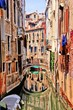 Quaint canal in Venice with reflection, Italy