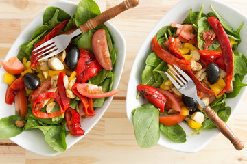 Two delicious bowls of baby spinach salad