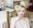 beauty emotional blond bride in luxury interior