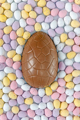 Chocolate easter egg surrounded