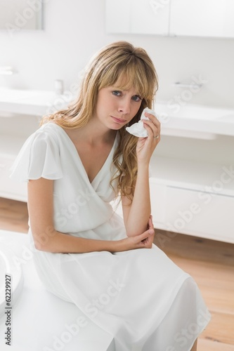 Portrait of a sad woman crying in bathroom
