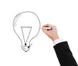 close up of businessman drawing light bulb