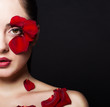 Fashion portrair of woman with rose petals