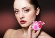 Beautiful woman with orchid