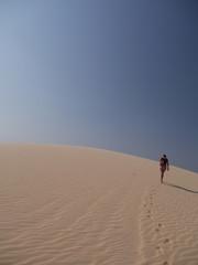 Desert solitude woman walking