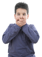 Surprised child closing his mouth with his hands