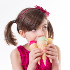 Little cute girl with ice cream over white