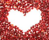 Heart shaped frame of pomegranate seeds