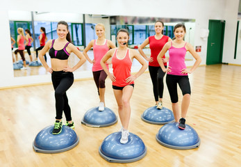 group of female doing aerobics with half ball