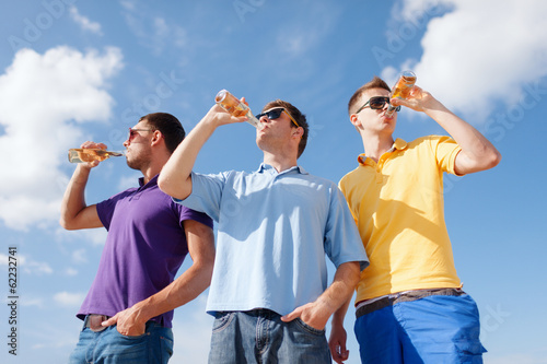 group of male friends with bottles of beer
