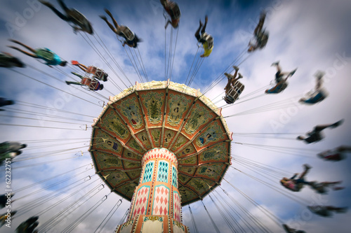 Foto op Canvas Carnaval spinning vintage swing ride