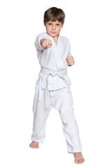Active little boy in kimono