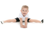 Little boy performs gymnastic exercises