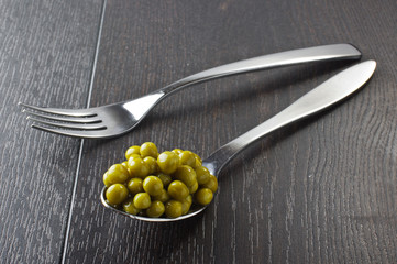 Peas in the spoon served