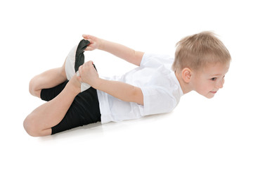 Little boy performs gymnastics