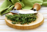 Fresh fragrant green thyme on a cutting board