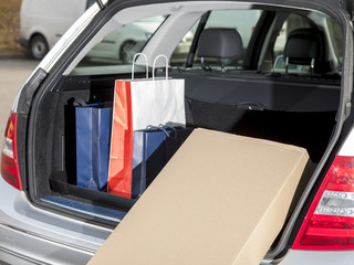 Open the trunk with shopping bags