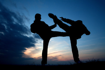 karate training in evening - silhouette