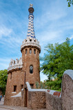 Little ginger house and walls on entrance of Park Guell at Barce