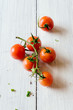 Ripe cherry tomatoes on white wooden table