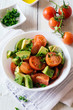 Healthy fresh cherry tomatoes and avocado salad