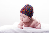 Close-up of sweet little newborn baby face with stocking cap