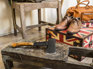 Hatchet and leather shoes.