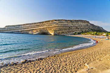 Matala beach and big rock with small caves, island of Crete