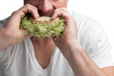 Adult Eating a Sandwich Full of Alfalfa Sprouts