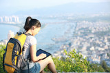 woman hiker use tablet seaside mountain peak