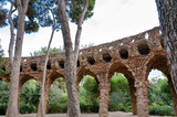 Viaducto arcs and trees in Park Guell at Barcelona